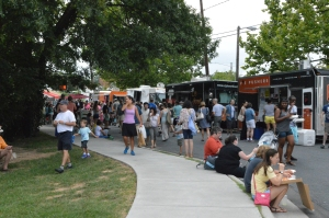 Food Trucks line-up on the road bordering Central Park and the Farmers Market