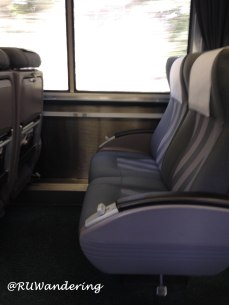 Typical configuration on an Amtrak train in coach. While an airline's first class seat is larger, a coach class seat is significantly larger than a airline's coach seat.