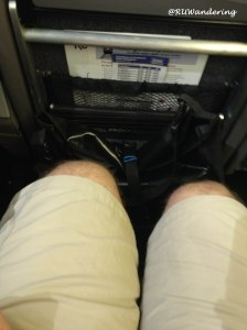 "Look at the distance between my knees and seat back. I can drop something without ""losing"" it."